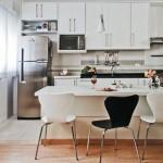 A cozinha americana é integrada a outros ambientes da casa. (Foto: Divulgação)