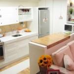A cozinha americana se comunica com os outros cômodos da casa. (Foto: Divulgação)