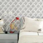 Papel de parede transforma o visual do quarto.