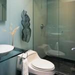 Abuse da transparência para deixar o banheiro mais elegante.