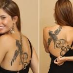 Tatuagem de fênix feminina nas costas (Foto: divulgação)