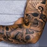 Tatuagem de caveira masculina no braço (Foto: divulgação)