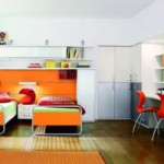 O laranja vibra na decoração deste quarto. (Foto:Divulgação)