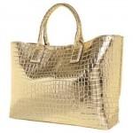 Bolsa feminina grande e dourada. (Foto:Divulgação)