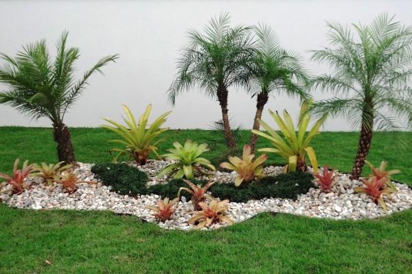de Oásis, com pedras, mini coqueiros e gramado (Foto Divulgação