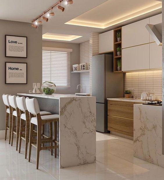 cozinha planejada pequena com ilha em marmore