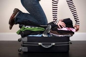 Mulher arrumando as malas